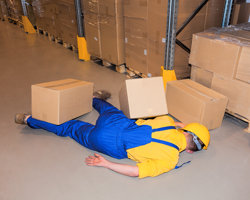 Man injured in a warehouse, three day first aid at work training available throughout Lincolnshire